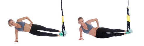 TRX side plank with hip drop royalty free stock photo