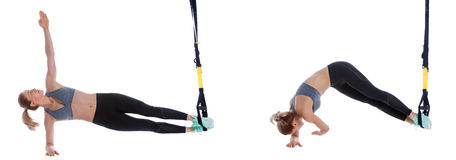 TRX side plank with reach Stock Photo