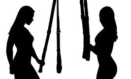 TRX suspension training. Two silhouette of sporty girl. TRX suspension training Royalty Free Stock Images