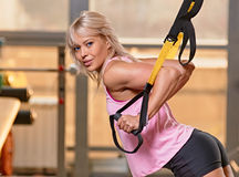 TRX training indoor. woman portrait Stock Image
