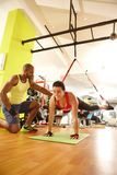 TRX workout with personal trainer Stock Photo