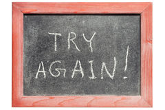 Try again. Exclamation handwritten on isolated vintage blackboard royalty free stock photography