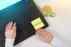 Try Again Restart Retry Persistence Endure Concept. Text Restart, from wooden letters on a paper sticker. Background laptop, woman. `s hands on the keyboard Royalty Free Stock Photo
