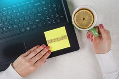 Try Again Restart Retry Persistence Endure Concept. Text Restart, from wooden letters on a paper sticker. Background laptop, woman`s hands on the keyboard Royalty Free Stock Photos