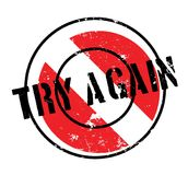 Try Again rubber stamp. Grunge design with dust scratches. Effects can be easily removed for a clean, crisp look. Color is easily changed Stock Photography