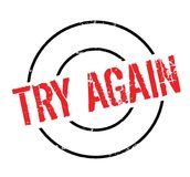 Try Again rubber stamp. Grunge design with dust scratches. Effects can be easily removed for a clean, crisp look. Color is easily changed Stock Photo
