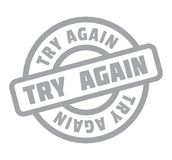 Try Again rubber stamp. Grunge design with dust scratches. Effects can be easily removed for a clean, crisp look. Color is easily changed Royalty Free Stock Photography