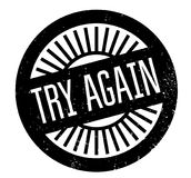 Try Again rubber stamp. Grunge design with dust scratches. Effects can be easily removed for a clean, crisp look. Color is easily changed Royalty Free Stock Images