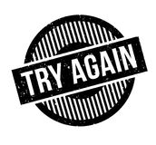 Try Again rubber stamp. Grunge design with dust scratches. Effects can be easily removed for a clean, crisp look. Color is easily changed Stock Images
