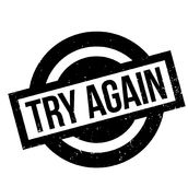 Try Again rubber stamp. Grunge design with dust scratches. Effects can be easily removed for a clean, crisp look. Color is easily changed Royalty Free Stock Image