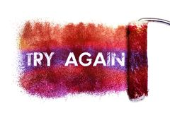 The try again word painting. Color full on white paper by roll painter,isolated Stock Image