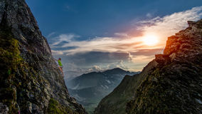 Try climbing at sunset. In the mountains stock photography