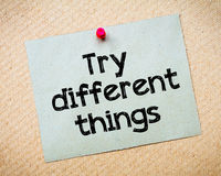 Try different things. Message. Recycled paper note pinned on cork board. Concept Image Stock Photography