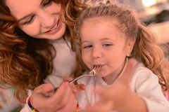 Beautiful young mommy being in cafe with her child royalty free stock photography