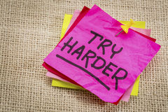 Try harder motivation sticky note Stock Photo