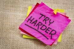Try harder motivation sticky note Stock Photo