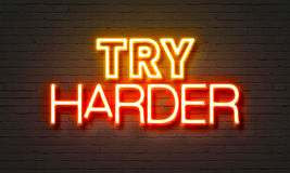 Try harder neon sign on brick wall background. Royalty Free Stock Photography