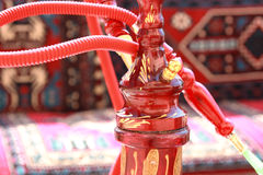 Try the hookah!. The hookah in traditional asian cafe Royalty Free Stock Photo