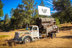 Try Jesus Sign on Abandoned Truck. Coulterville, California - July 27, 2014: A billboard sign placed on broken down truck in a meadow reads `Try Jesus He Never Stock Photos