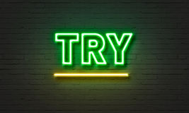 Try neon sign on brick wall background. Stock Photography