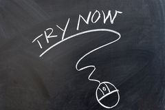 Try now. Words and mouse drawn on chalkboard royalty free stock photos