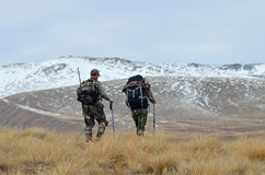Try over here. Two hunters searching for Himalayan tahr in the Southern Alps of New Zealand Stock Photos