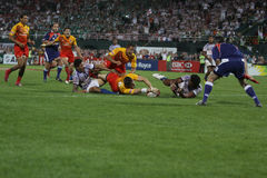 A try is scored at the Dubai Rugby Sevens Stock Photo