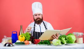 Try something new. Cookery on my mind. Cooking skill. Book recipes. According to recipe. Man bearded chef cooking food. Check if you have all ingredients. Cook royalty free stock photography