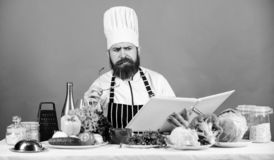 Try something new. Cookery on my mind. Cooking skill. Book recipes. According to recipe. Man bearded chef cooking food. Check if you have all ingredients. Cook stock images