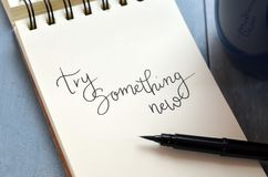 TRY SOMETHING NEW hand-lettered in notepad royalty free illustration