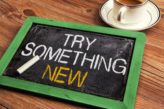 Try something new. Handwritten on small blackboard Royalty Free Stock Photos