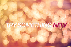 Try something new. Inspiration quote  TRY SOMETHING NEW  and bokeh background Stock Photos