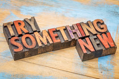 Try something new in wood type. Try something new - motivational advice in vintage letterpress wood type printing blocks stock image