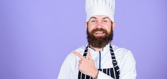 Try something special. Special offer from chef. Confident bearded happy chef white uniform. My secret tips culinary royalty free stock images
