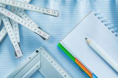 Try square checked notepad pencil tape measure Stock Images