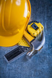 Try square tape-measure building helmet and claw Stock Image