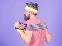 Try stretching exercise. Athlete sport instructor. Lets stretch arms. Athlete stretching with expander. Sportsman. Training stretching expander. Man bearded stock photo
