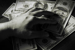 Try to keep money. Stock Photography