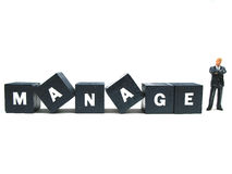 Try to manage. A manager standing besides the word manage stock photo