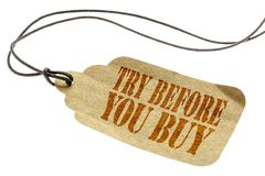 Try before you buy - price tag. Try before you buy - a paper price tag with a twine isolated on white stock photography