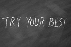 Try your best motivational phrase on blackboard Stock Photography