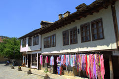 Tryavna town shop,Bulgaria. Street with old Revival houses and colorful scarves for sale outdoor display in Tryavna.Tryavna is a town in central Bulgaria stock photo