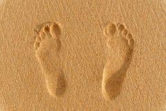Tryck för mänsklig fot på sanden Arkivbild
