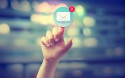 Trycka på för hand en emailsymbol royaltyfria bilder