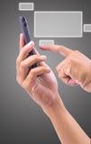 Trycka på för hand en knapp på en pekskärm Fotografering för Bildbyråer