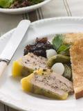 trycka på för peppercorns för foiegras grönt Arkivfoton
