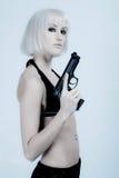 tryckspruta som rymmer den sexiga kvinnan Arkivfoto