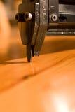 trycksprutahuvudet spikar Arkivfoton