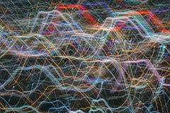 Tryckvågzoomeffekt, ljusa linjer med lång exponering Arkivfoto