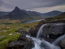 Tryfan in spring with the Afon Lloer in flow over the waterfalls, Wales stock photo